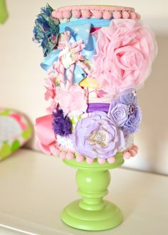 DIY headband holder - using an oatmeal canister, a candle pillar and fun fabric/pompom trim!
