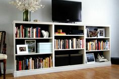 3billy bookcases from IKEA. long trim at the top/bottom to unify it all.