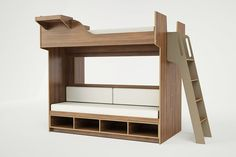 This loft bed doubles as couch seating and storage space. Click through for more grownup friendly bunkbeds.