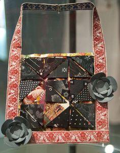 Lucy Sarneel - Mourning Piece (2008). Necklace: antique textiles on rubber, silver, thread, zinc. Photo by Eleni Roumpou