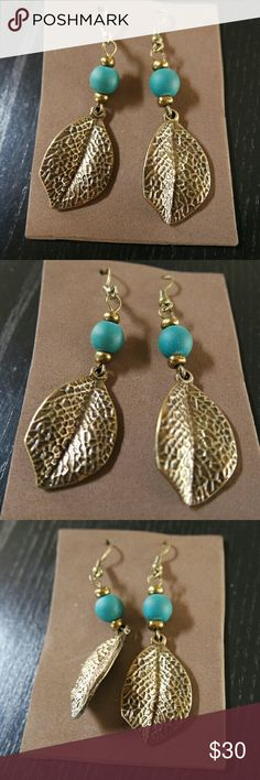 Leaf shaped metal and seed earrings from Mexico These beautiful earrings are hand made by Mexican artisans in the state of Jalisco.  #mexican  #artisan  #handmade  #metal  #painted  #seeds   ***Note: there may be slight differences on each earing due to it being handmade*** Jewelry Earrings