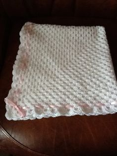 White crocheted baby blanket with pink ribbon by Happilyevercrafts, £9.50