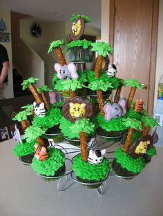 Jungle Theme Baby Shower Cupcakes - Decorated display includes various animals with Pretzel Trees. Jungle Theme Birthday, Jungle Theme Parties, Baby Boy Birthday, Jungle Party, Boy Birthday Parties, Baby Party, Party Themes, Party Ideas, Jungle Theme Food