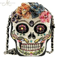 No need to wait for Halloween to make a fearless fashion statement. Inspired by the month long Mexican celebration featuring sugar skulls made of edible candy, Sugar Rush lets you show the world your trendsetting charm in all of its dazzling glory. From the esteemed Mary Frances collection comes this daring handbag that's the ultimate conversation piece, especially among sugar rush fans. Meticulously handcrafted with endless beadwork in an eye-popping design, this themed sugar skull purse…