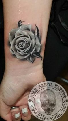 Black and grey rose tattoo.
