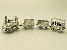 'Dutch Sterling Silver Model Train' A fine and impressive, unusual antique Dutch sterling silver model of a train.