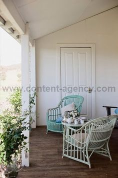 Love the mismatched coloured cane chairs.  Would love to find some for front patio