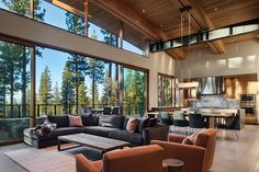 Martis Camp home blends in yet stands out with a simple arc and geometric masses The steep contours of Martis Camp lot 517 called for a structure that was as integrated as it would be beautiful. The singular simplicity of a crisp arc, grounded. Modern Mountain Home, Colorado Homes, Modern House Design, Home Living Room, Great Rooms, Home Interior Design, Luxury Homes, House Plans, New Homes