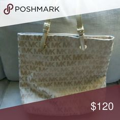 Micheal Kors Jet Set Brand new Jet Set handbag by Micheal Kors.  100% Authentic.  New,  but tags are off.  Tan in color with gold straps. Make me an offer.  I will also be putting up more items soon,  so check back! Michael Kors Bags Shoulder Bags