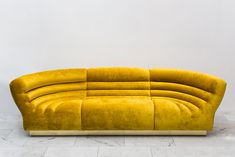 The Channel Tufted Racetrack Sofa / Sectional