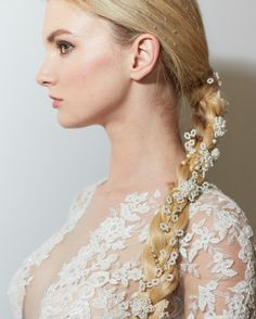 Take a page from Reem Acra and weave pearls and jewels throughout a romantic braid. To create the look, Davines Master Session Ambassador Joseph DiMaggio prepped hair root to tip with Davines Essential VOLU Hair Mist ($34, davines.com) for a lived-in texture. He then created a clean middle part and scraped hair back into a ponytail at the nape of the neck. (For more drama, or for short-haired gals, DiMaggio swears by LOX Extensions.) After braiding hair and securing it with an elastic, he…