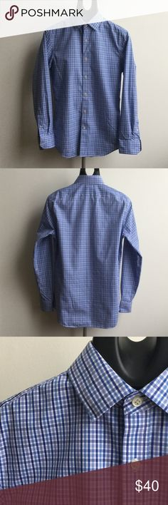 Banana Republic Non-Iron Tailored Slim Fit 100% cotton;  non-iron;  slim fit;  button up;  can be dressed up as work shirt or dressed down for a casual look;  color - white and blue multi plaid;  never worn Banana Republic Shirts Dress Shirts