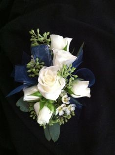 Cream Spray Roses, white Waxflower, Seeded Eucalyptus, with sheer navy ribbon.