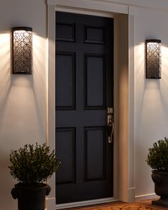 Inspired by garden gate scroll work, the Arramore outdoor wall sconces by Feiss feature a modern linear silhouette enhanced by advanced LED technology that warms in color when dimmed, going from a crisp white light to a soft, candle light glow. Outdoor Wall Lantern, Outdoor Wall Sconce, Outdoor Wall Lighting, Living Room Lighting, Home Lighting, Driveway Lighting, Lighting Design, Led Wall Sconce, Wall Sconces
