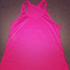 Hot pink Nike workout tank Never worn - hot pink - light weight - perfect condition - has pink Nike symbol on bottom right hand corner of article that isn't featured in the picture Nike Tops Muscle Tees
