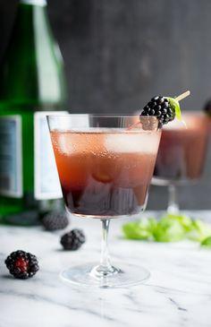 Blackberry Basil Shrub Collins   2 ounces vodka  2 ounces blackberry basil shrub  4 ounces sparkling water  basil leaves and blackberries for garnish