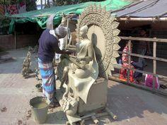 A sculptor at work outside Dhakeshwari Temple in Dhaka, Bangladesh. Gypsum Decoration, Gypsum Wall, Dhaka Bangladesh, Ceiling Rose, Temple, Lion Sculpture, Temples