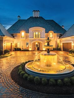 A Family's Forever Estate by Nor-Son. A dramatic blend of stonework, pervious pavers, and fountain in the semicircle drive enhances the timeless beauty of the home.