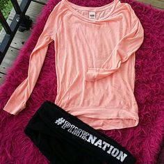 BRIGHTCORAL RAGLEN PINK V.S. OFF SHOULDER TOP  V.S. PINK L/S cotton bright coral  color. Pair w leggings  or  pair of shorts. This is very loose fitting.  Hangs off the shoulder.  Too cute  layer this  with a  tank or bandeau ..(THESE  LEGGINGS  ARE NOT FOR SALE ) ** LAST DROP *** PINK Victoria's Secret Tops