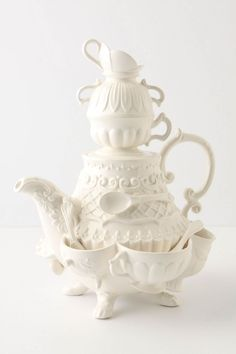 Stanhope Teapot. Dainty layers of cups and bowls fan outwards, like the tiered layers of a woman's 18th century dressing gown.