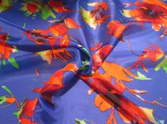 Royal Blue with Burnt Orange Floral Print by fabricsandtrimmings