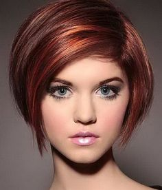 Short layered bob with feathering and ends that are curved inward.