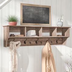 Ideal for an ever-expanding household, this wall-mounted coat rack is a stylish storage solution for your entryway, foyer or mudroom. Made from manufactured wood with laminate veneers in a drifted gray finish, this rustic design incorporates four spacious cubbies and nine black satin metal hooks. With room for everyone in your family, the baskets can be filled with gloves, mittens, hats and books, while five large and four small hooks provide plenty of places to hang jackets, coats, hoodies…