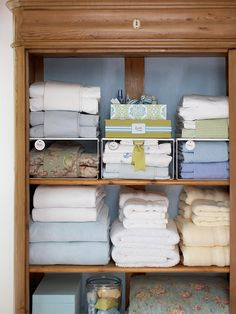 Linens are bundled together and storage space is gained by adding simple wire shelves.