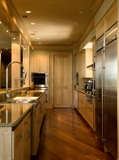 Beautiful stained Maple floors installed at a diagonal.  Nice cabinets and door accent the flooring very well!