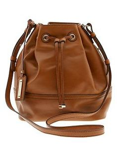 Banana Repulbic Cognac Dalia Bucket Bag, easy for toting around on a summer day.