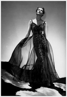 April Harper's Bazaar 1937 Wearing a gown by Madame Grès, photo by George Platte Lynes.