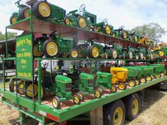 John Deere pedal tractors up & down the trailer