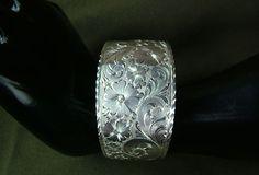 Western Bright Cut engraved Sterling Silver Cuff Bracelet. $300.00, via Etsy.