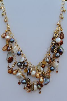 Splenderosa Pearl Strand Double Bib Necklace With dangling drops of brown (Hessonite) garnets, green amethyst, citrine, white topaz, on goldfilled chain Pearl Jewelry, Wire Jewelry, Jewelry Crafts, Jewelry Art, Beaded Jewelry, Jewelery, Jewelry Accessories, Jewelry Necklaces, Fashion Jewelry