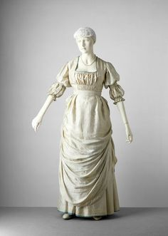 """Dress, silk lined with cotton, V no. T.171 to I-1973. """"The dress was made and worn by the wife of Sir Hamo Thornycroft (1850-1926). He was a sculptor and designed it for her. They were both interested in the dress reform movement and conceived the dress in accordance with the movement's principles so it did not restrict the waist and arms."""""""