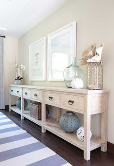 HGTV features a transitional coastal neutral dining room with a coastal style dining room buffet table and framed beach photos. Coastal Bedrooms, Coastal Living Rooms, Living Room Decor, Cozy Living, Bedroom Decor, Foyer Decorating, Decorating Ideas, Decor Ideas, Beach House Decor