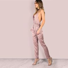 Go from 0 to 90's in one jumpsuit. The Knock Em Dead Satin Jumpsuit comes in satin and features a Plunge neckline, skinny leg silhouette, Gender: Women Type: Jumpsuits Material: Spandex,Polyester Decoration: Ruffles Length: Ankle-Length Pants Fabric Type: Satin Fabric: Fabric has no stretch
