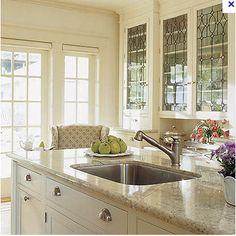 Cream cabinets with a light colored stone counter top - **dead link**