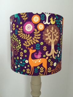 Handmade with Love. Using Michael Miller Fantasy Forest Fabric. Lampshade available in different sizes to fit ceiling light or lamp base