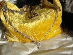 See the photo of a Couture handbag I designed for the yellow Dior Galliano gown. Note how they were just made for each other, and the uniqueness of the luxury hand-made Couture handbag adorned in crystals and real pearls. It is in true harmony with the symphony that resounds with couture extravagance!