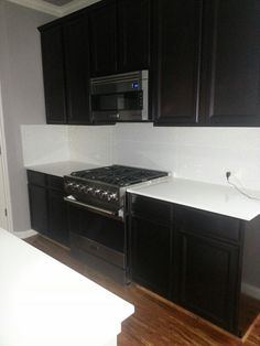 Kitchen viking and porcelanosa. Extreme white silestone quartz counters.