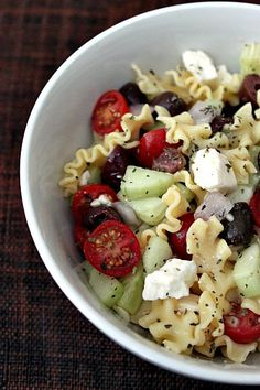 Greek Pasta Salad  5 oz dry Lasagnettes pasta, uncooked (about 1 ½ cups)  ½ pint cherry tomatoes, sliced in half  1 cup cucumber, diced, seeded (peeled or unpeeled)  1 cup  pitted Kalamata olives, drained  ½ cup red onion, diced  3 oz  good quality feta cheese, crumbled  ¼ cup Greek Salad Dressing (recipe follows)  Coarse ground black pepper  Oregano    Cook pasta according to package directions.
