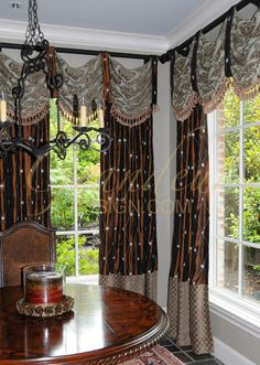 I'd want lighter fabric for the drapes themselves, but I like this set up.
