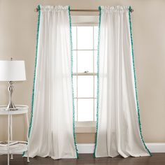 Love these white linen pom pom tassel curtain window panels. Available with aqua blue, pink and black pom poms