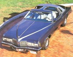 1977 Pontiac Grand Prix. Big and bold. My graduation present from High School ! Mine was black with red interior
