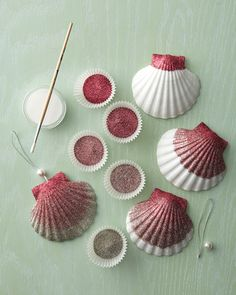 Glittered Shell Ornaments. I have TONS of seashells. How pretty would these be on a beach themed tree? As well as getting those clear glass ornaments and filling them with small shells. :)