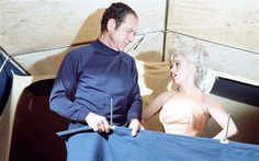 Sid James and Barbara Windsor trying to get it up in Carry On Camping