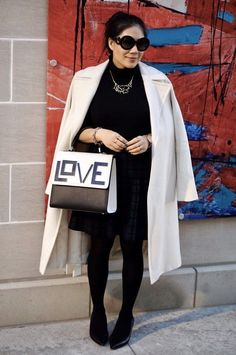 White coat with black heels outfit. Great fashion look for the office. You can wear it with boots, a dress. Great women style.