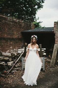 A beautiful bride wearing a Tatyana Merenyuk wedding dress and self-made floral crown for her Tipi wedding at Hill Place in Swansea. Photography by Marshal Gray.