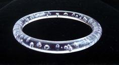 Vintage Bangle Bracelet in Clear Lucite Bubbles Unique by BlueberrySkyVintage on Etsy https://www.etsy.com/listing/204262593/vintage-bangle-bracelet-in-clear-lucite